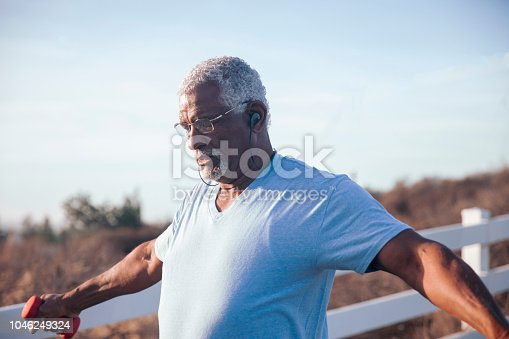 A senior black man working out with weights
