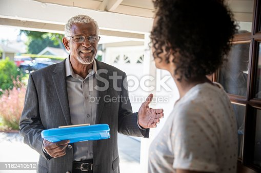 istock Senior Black Politician Door to Door 1162410512