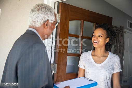 istock Senior Black Politician Door to Door 1162410526