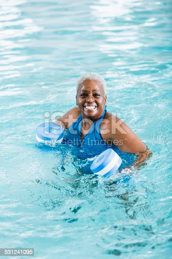 612839448istockphoto Senior black woman exercising, doing water aerobics 531241095