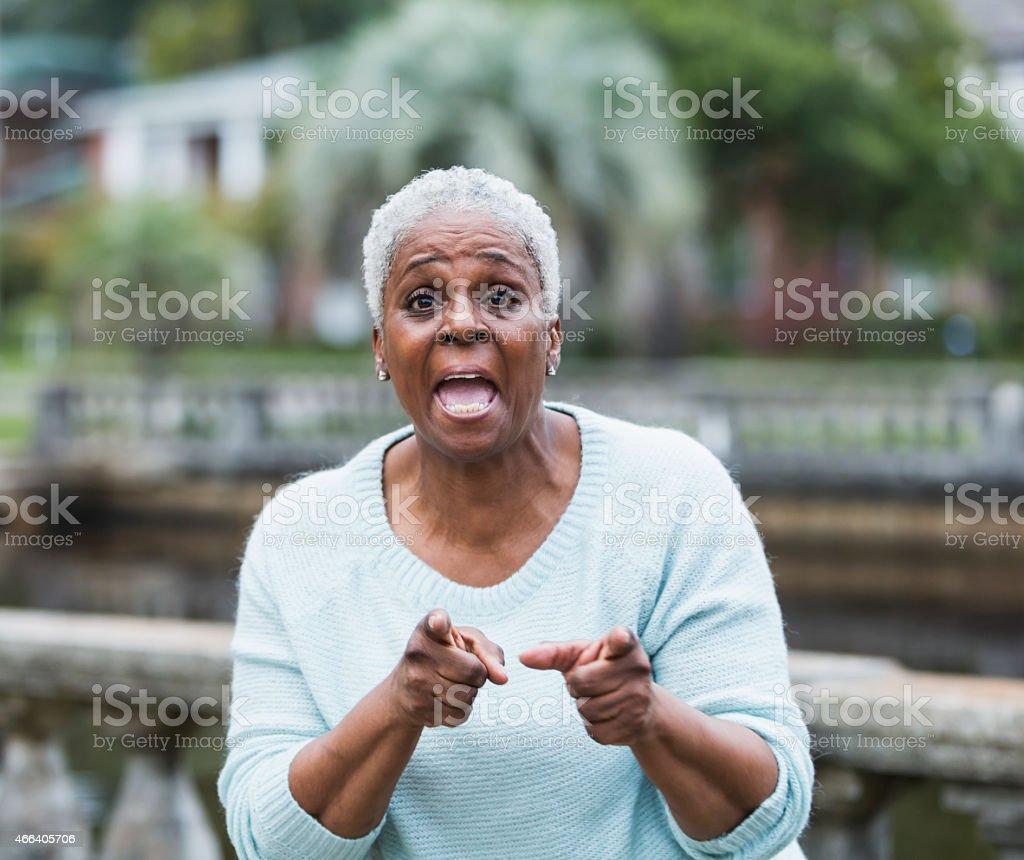 Senior black woman making a point stock photo