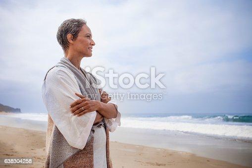 istock Senior Black Woman Relaxing on Beach 638304258