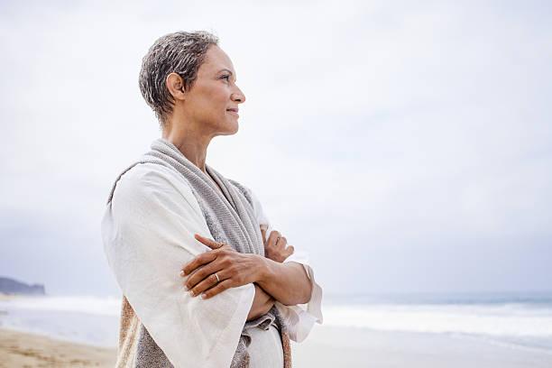 Senior Black Woman Relaxing on Beach stock photo