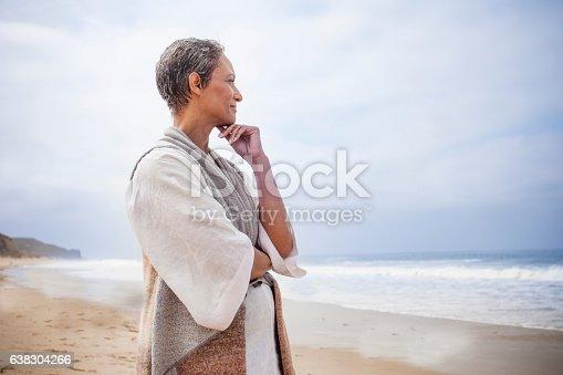 istock Senior Black Woman Relaxing on Beach 638304266