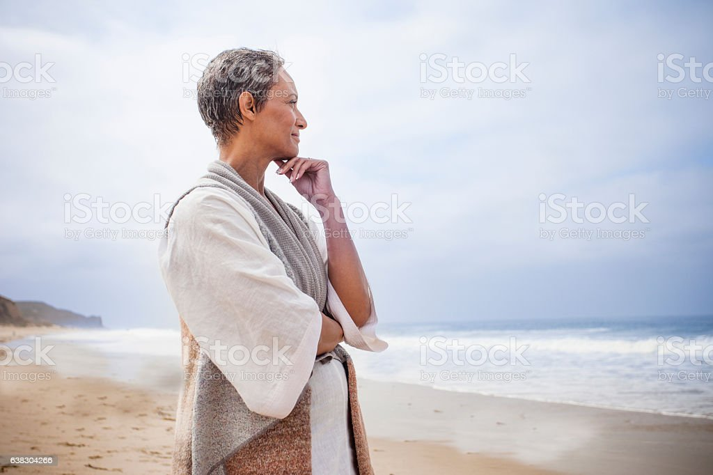 Senior Black Woman Relaxing on Beach stock photo