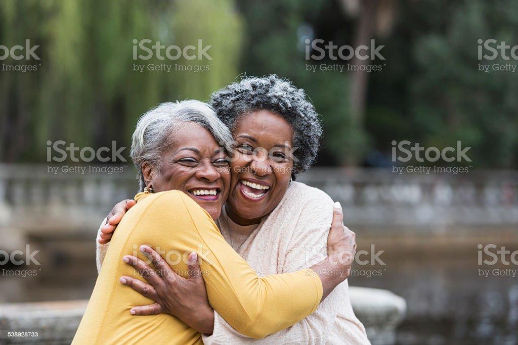 Senior black women embracing stock photo