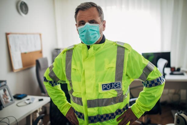 Senior British police officer with protective mask stock photo