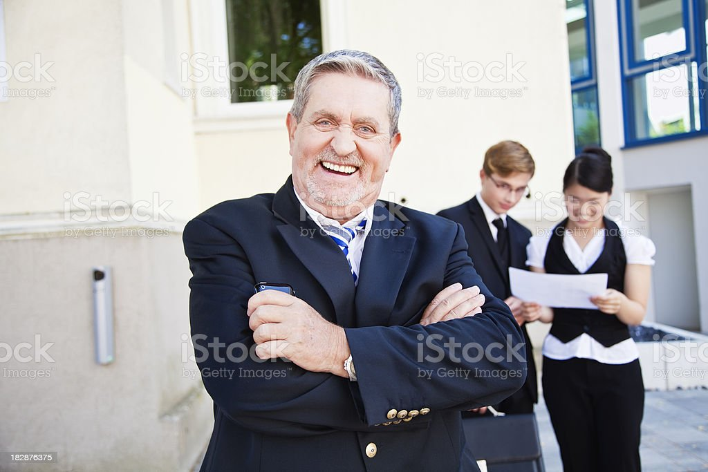 senior business man and team royalty-free stock photo