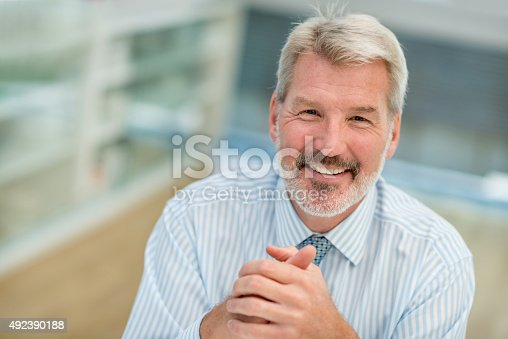 istock Senior business man at the office 492390188