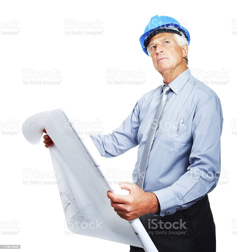 Senior business man holding blue print looking away royalty-free stock photo