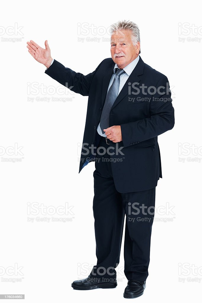 Senior business man presenting stock photo