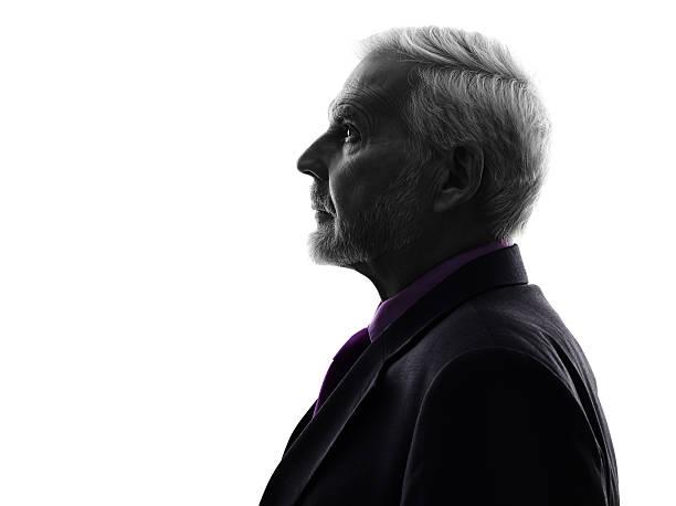 senior business man silhouette - arkadan aydınlatmalı stok fotoğraflar ve resimler