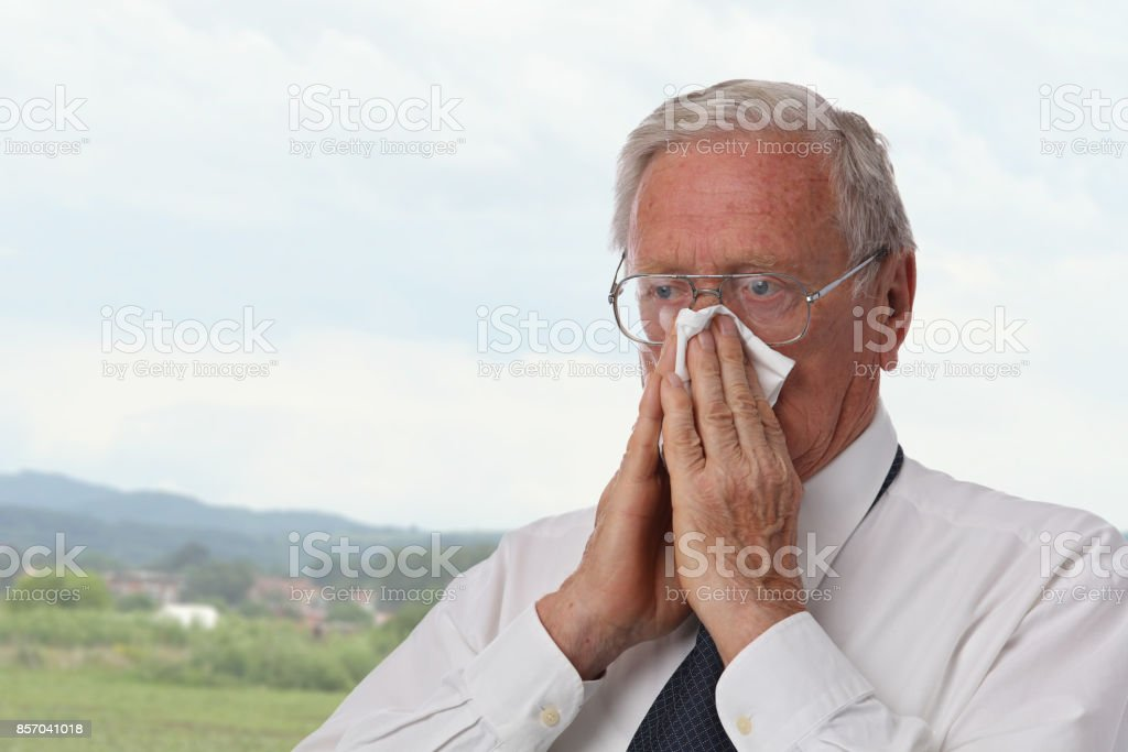 Senior Business Man Sneezing Into Tissue Flu Allergy Runny Nose