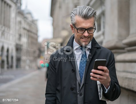 istock Senior business man texting on his smart phone 517927234