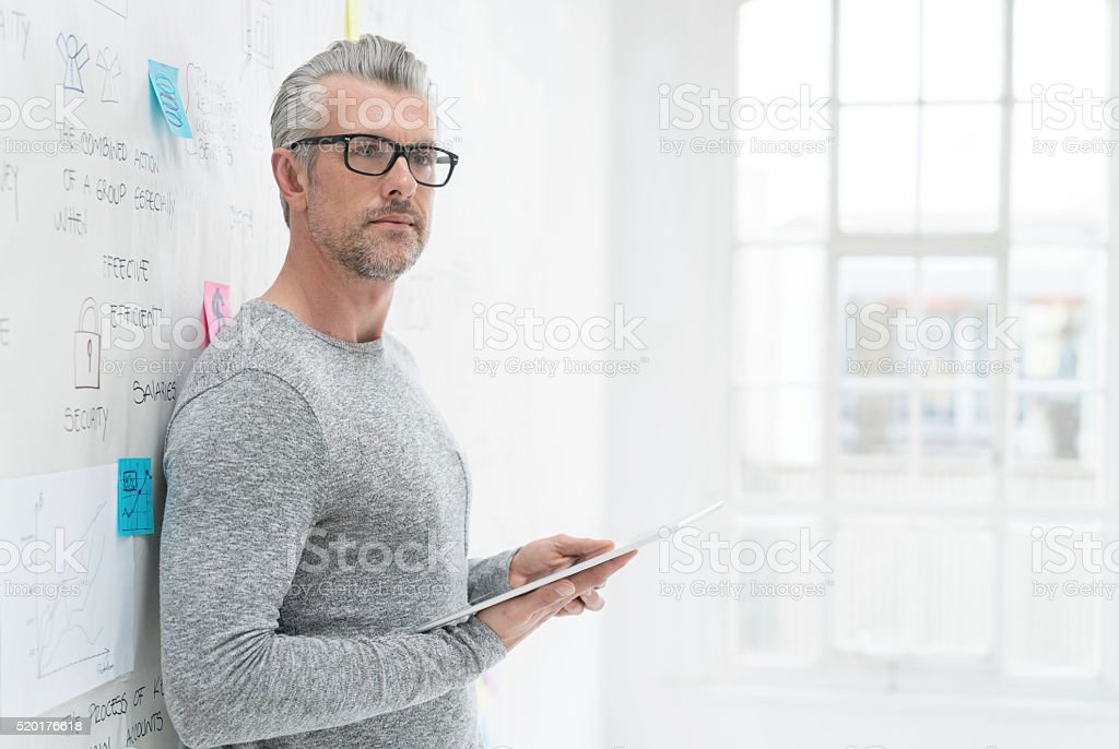 Senior business man using a tablet stock photo