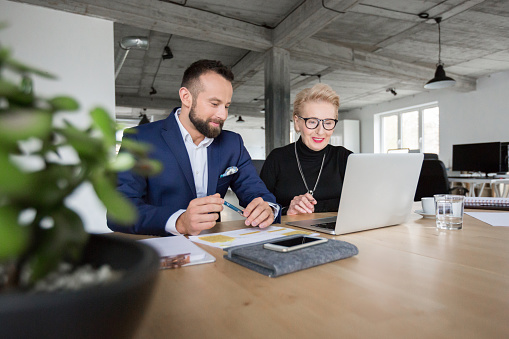 Senior Business Management Team Working Together Stock Photo - Download Image Now