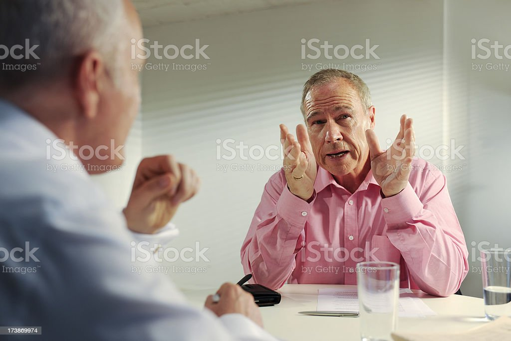 senior business men in meeting royalty-free stock photo