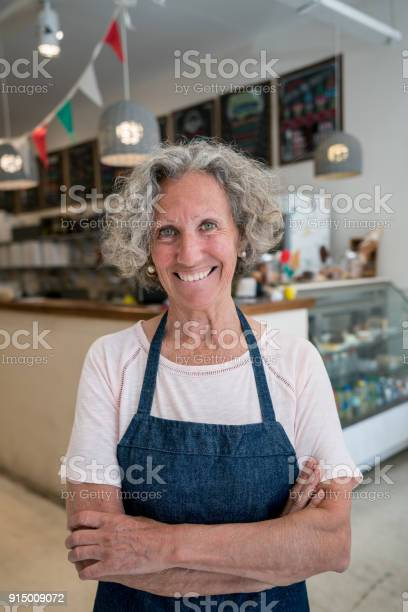 Senior business owner of her cafe looking at camera smiling with arms picture id915009072?b=1&k=6&m=915009072&s=612x612&h=krq8tfk6hvhmrwkgipskrybxc0 lh2pqaxcpejf4fya=