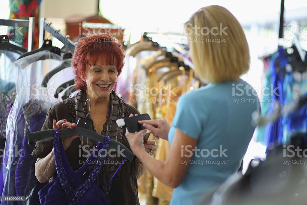 Senior Business Owner Using Credit Card Swiper on Mobile Phone royalty-free stock photo