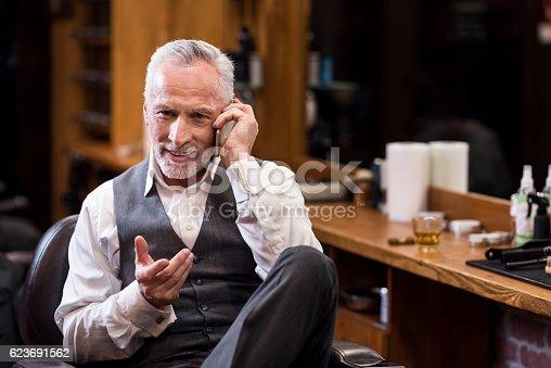 istock Senior business sitting man talking on mobile phone 623691562