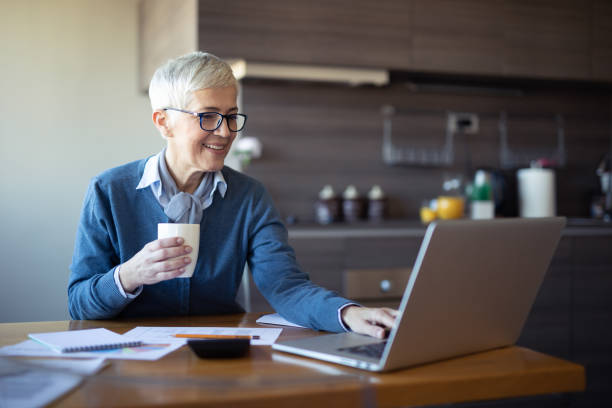 Senior business woman at home stock photo