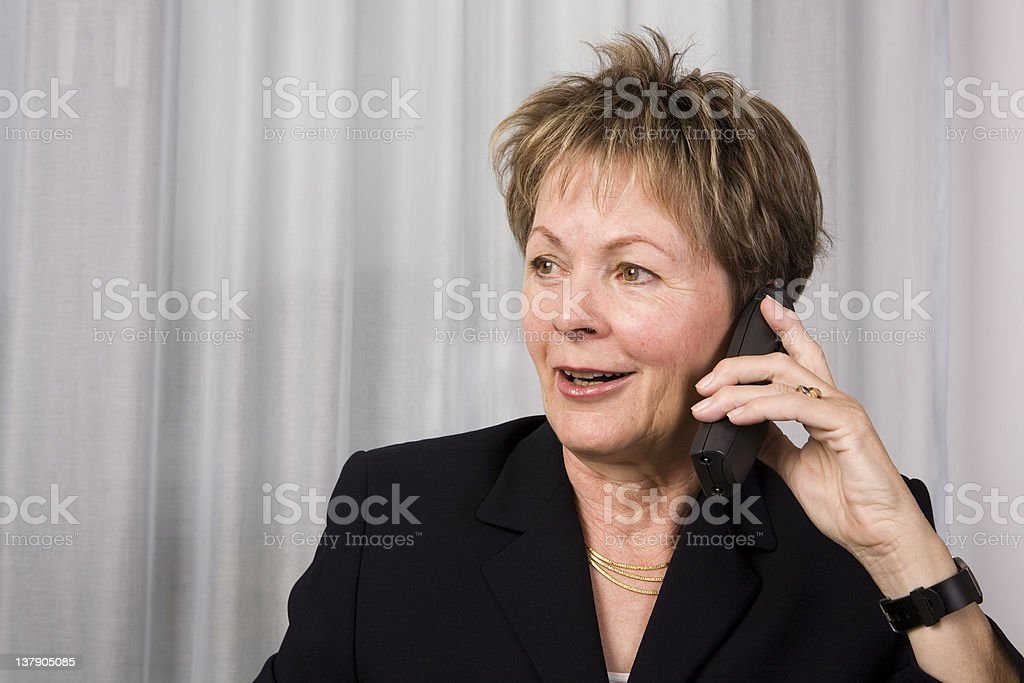 Senior business woman on the phone royalty-free stock photo