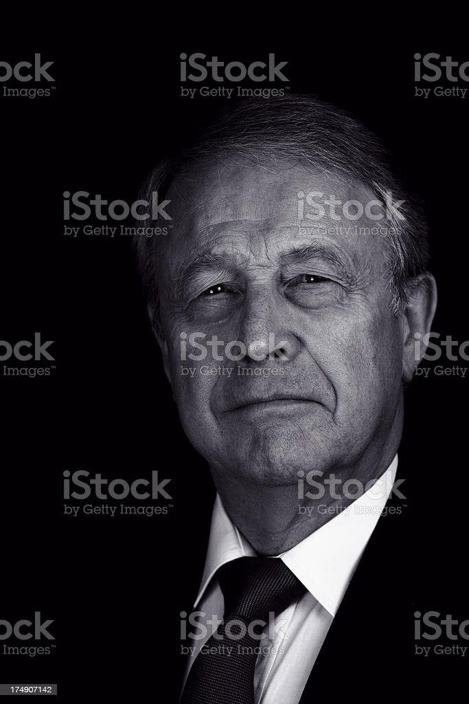 Senior businessman against a black background royalty-free stock photo