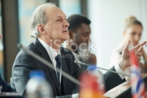 640177838 istock photo Senior businessman at conference 1199259003