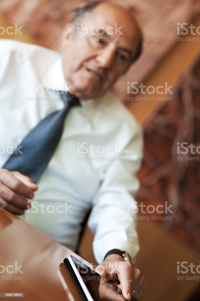 Senior businessman at the meeting royalty-free stock photo
