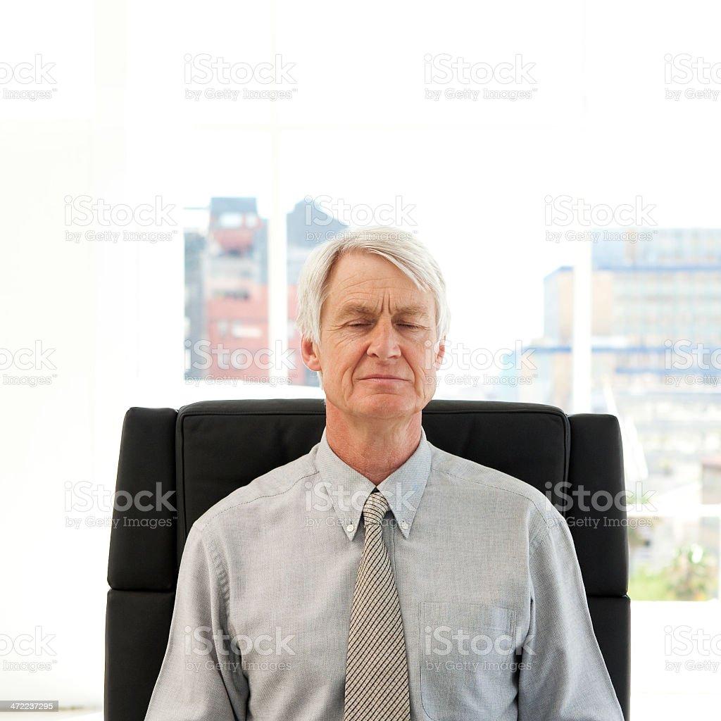 Senior businessman closing eyes stock photo
