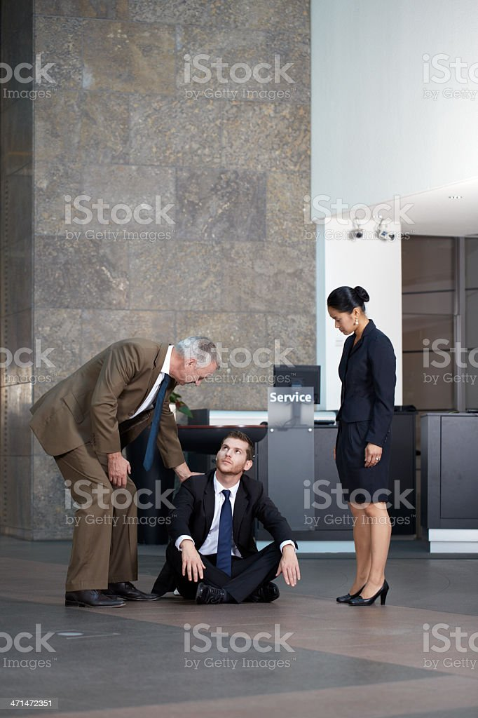 Senior businessman consoling his younger partner royalty-free stock photo