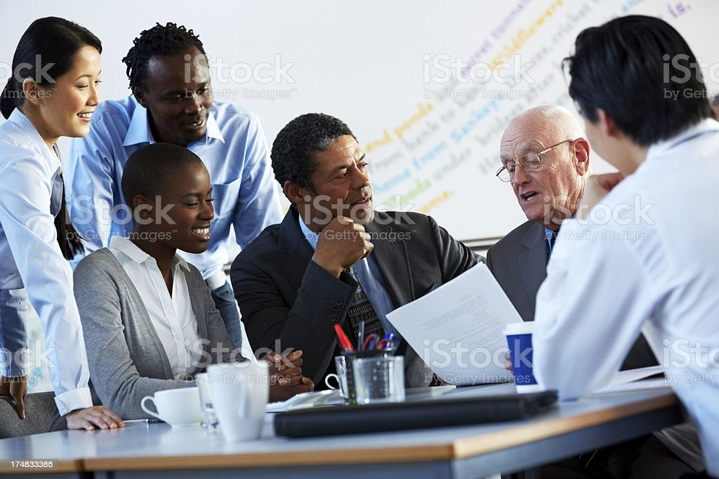 Senior businessman explaining a business proposal to colleagues royalty-free stock photo