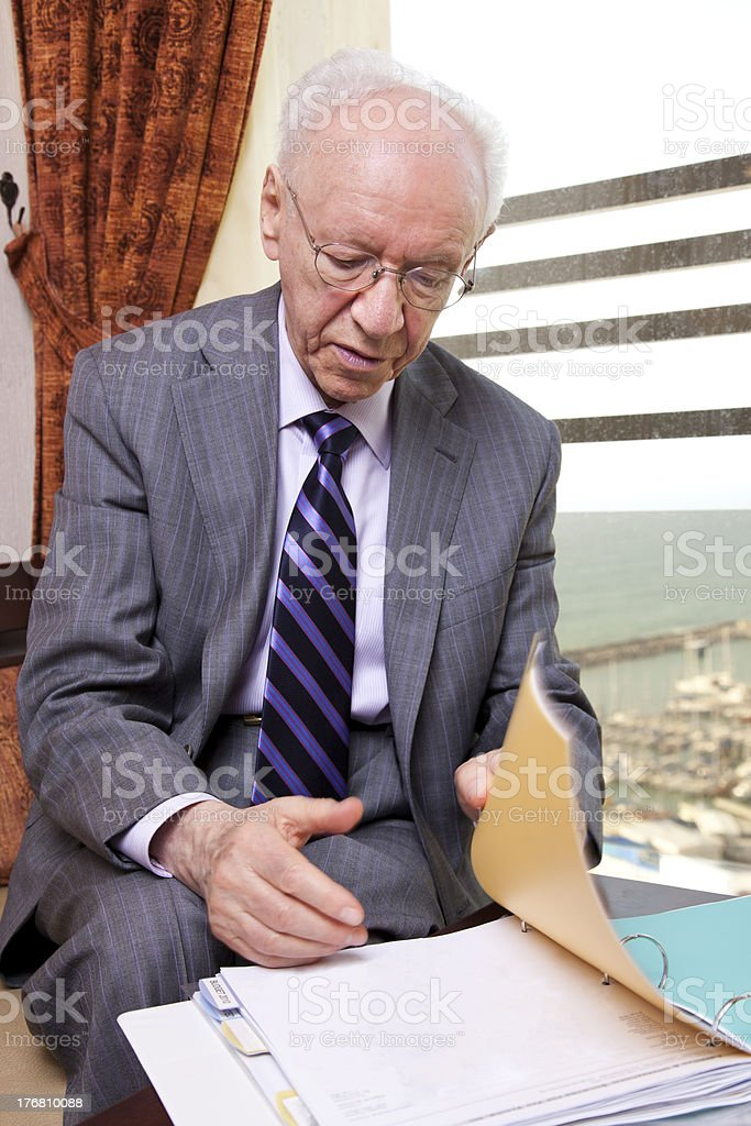 Senior Businessman Going Over Papers royalty-free stock photo