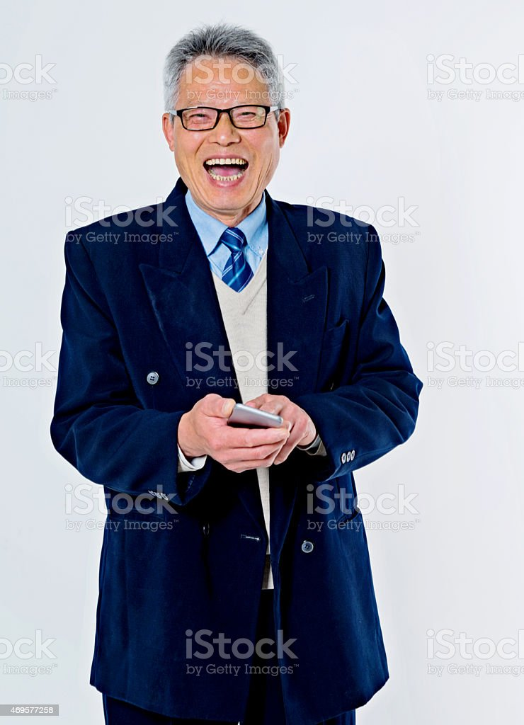 senior businessman holding a smart phone stock photo