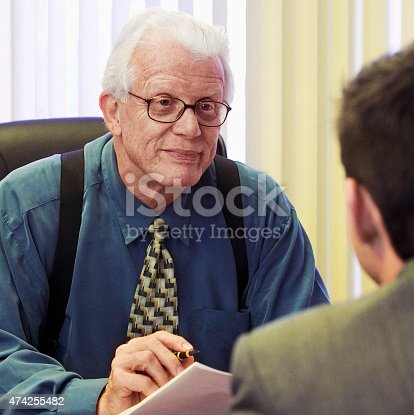 179607668istockphoto Senior businessman interviewing young hispanic businessman. 474255482