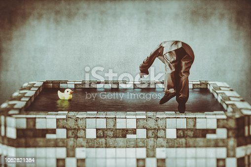 istock Senior businessman jumping into old, dirty pool 1052821384