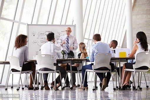istock Senior Businessman Leading Meeting At Boardroom Table 504990768