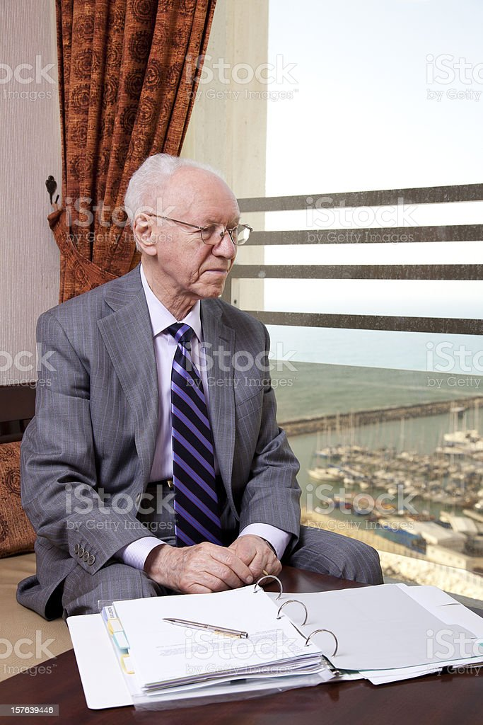 Senior Businessman Looking Out the Window royalty-free stock photo