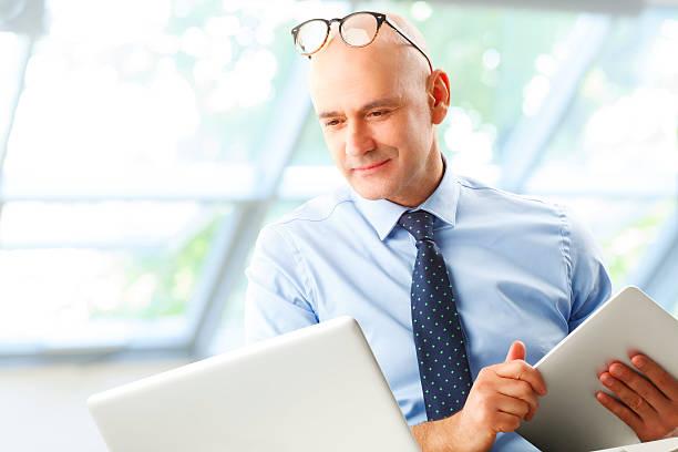 Senior businessman stock photo