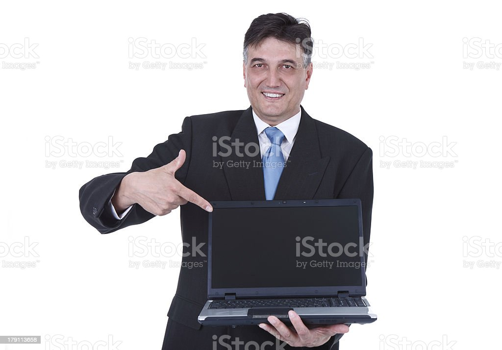 senior businessman pointing at laptop royalty-free stock photo