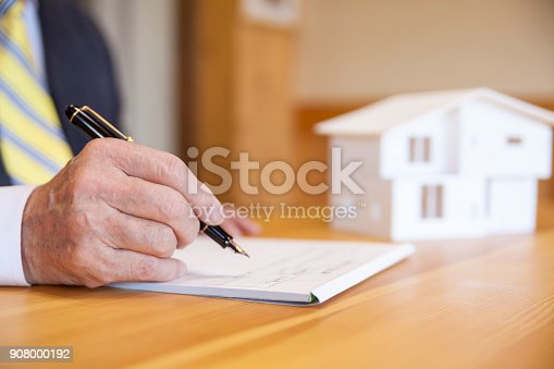 istock Senior Businessman Signing Contract 908000192