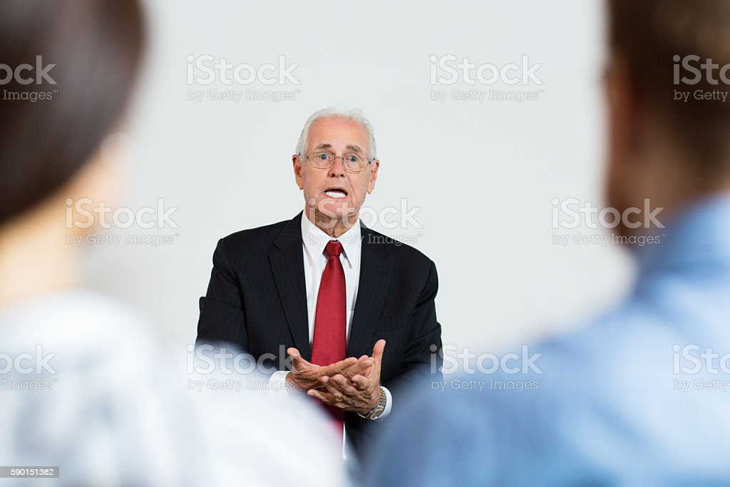 Senior Businessman Speaking Emotionally stock photo