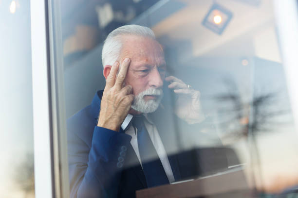 Senior businessman speaking on the phone stock photo