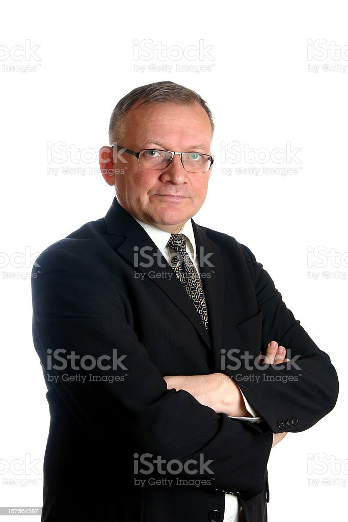 Senior businessman standing with arms crossed stock photo