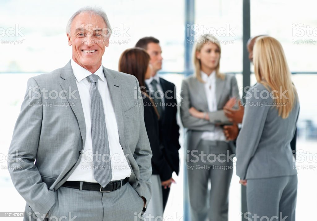 Senior businessman taking a break from meeting royalty-free stock photo