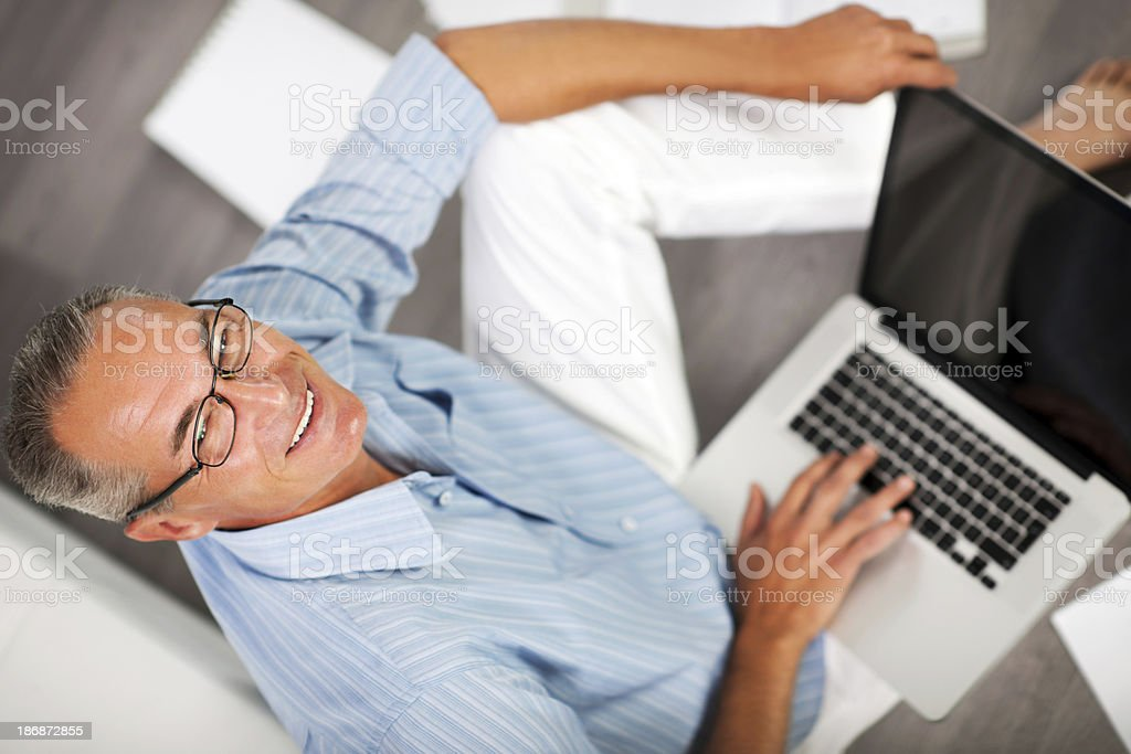 Senior businessman using a laptop. stock photo