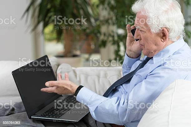 Senior Businessman Using Laptop Stock Photo - Download Image Now