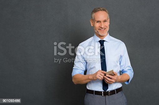 istock Senior businessman using phone 901093486
