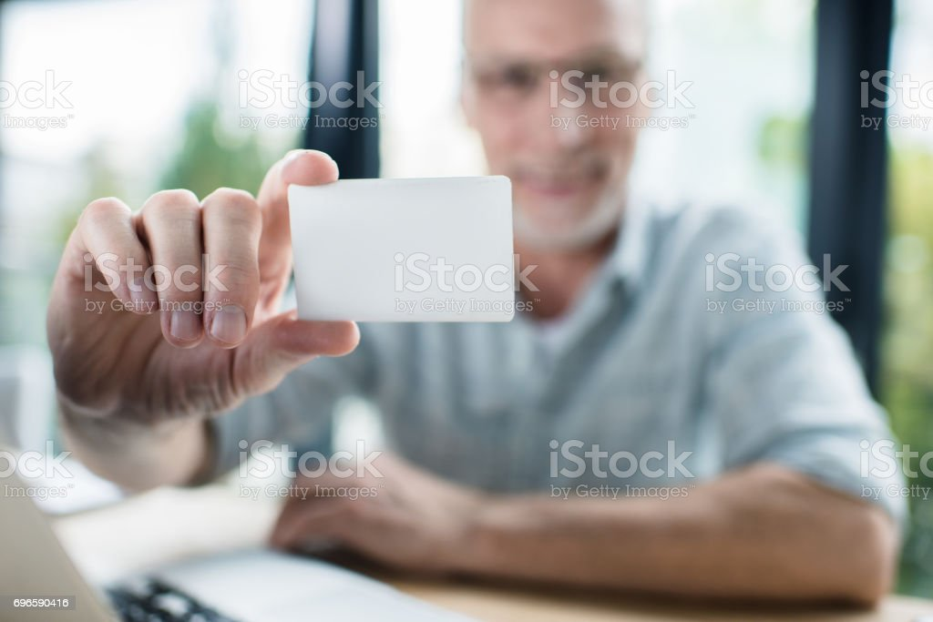Senior businessman with blank business card in hand stock photo senior businessman with blank business card in hand royalty free stock photo reheart Image collections