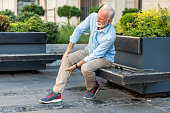 istock Senior Businessman with Knee Problems in the City Streets 1192546084